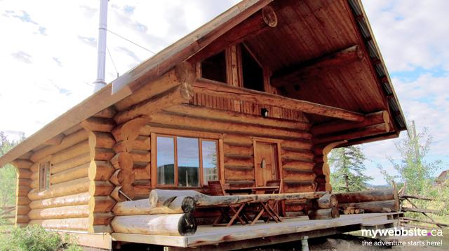 Private log cabins at Big Bar Guest Ranch